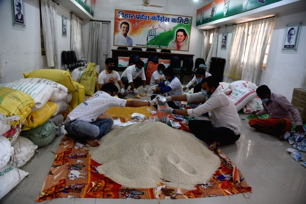 Congress workers make packages of foodgrains to be distributed among the poor, needy and homeless people during the extended nationwide lockdown imposed to mitigate the spread of coronavirus; ...