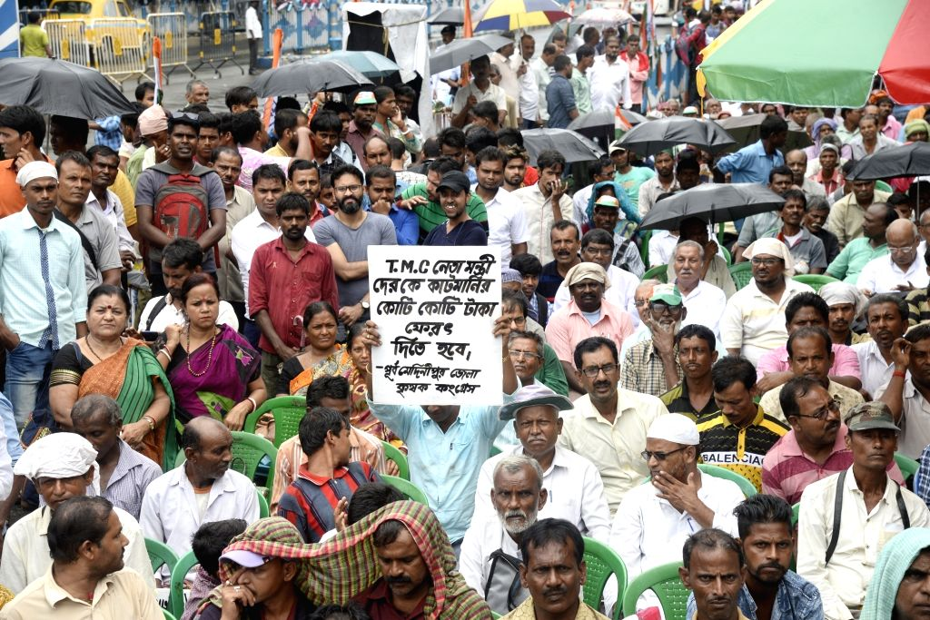 Congress workers participate during a rally organised to protest State and Union Government in Kolkata on Sep 12, 2019.