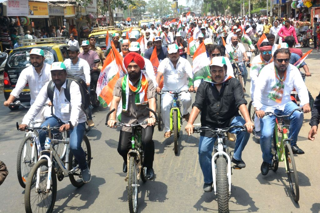 Congress workers participate in a cycle rally to protest against petrol and diesel price hike, in Mumbai on April 5, 2018.