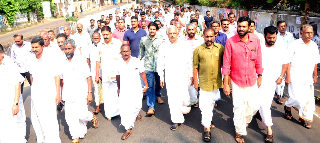 Congress workers participate in a march against demonetisation in Kannur of Kerala on Nov 28, 2016.