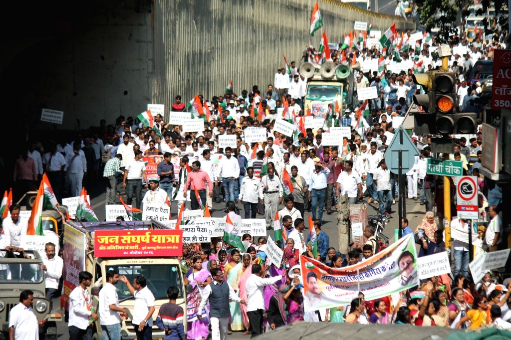 Congress workers participate in a march against demonetisation in Nagpur on Nov 28, 2016.
