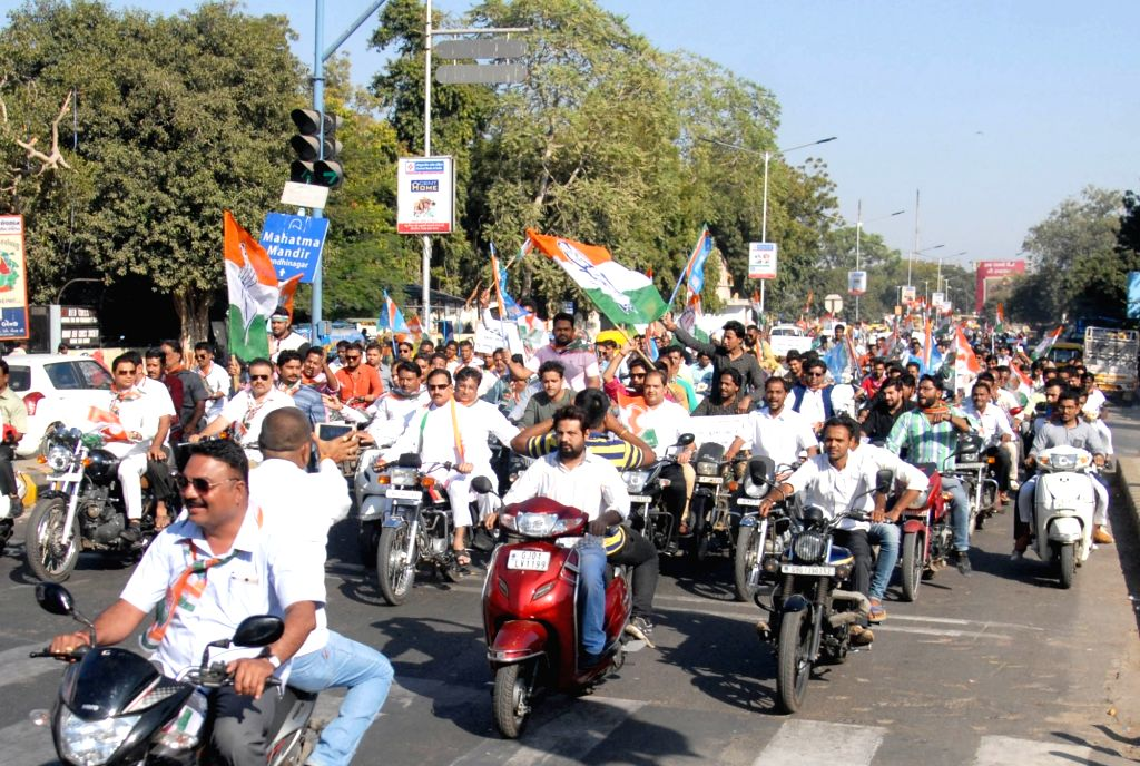 Congress workers participate in a march against demonetisation in Ahmedabad on Nov 28, 2016.