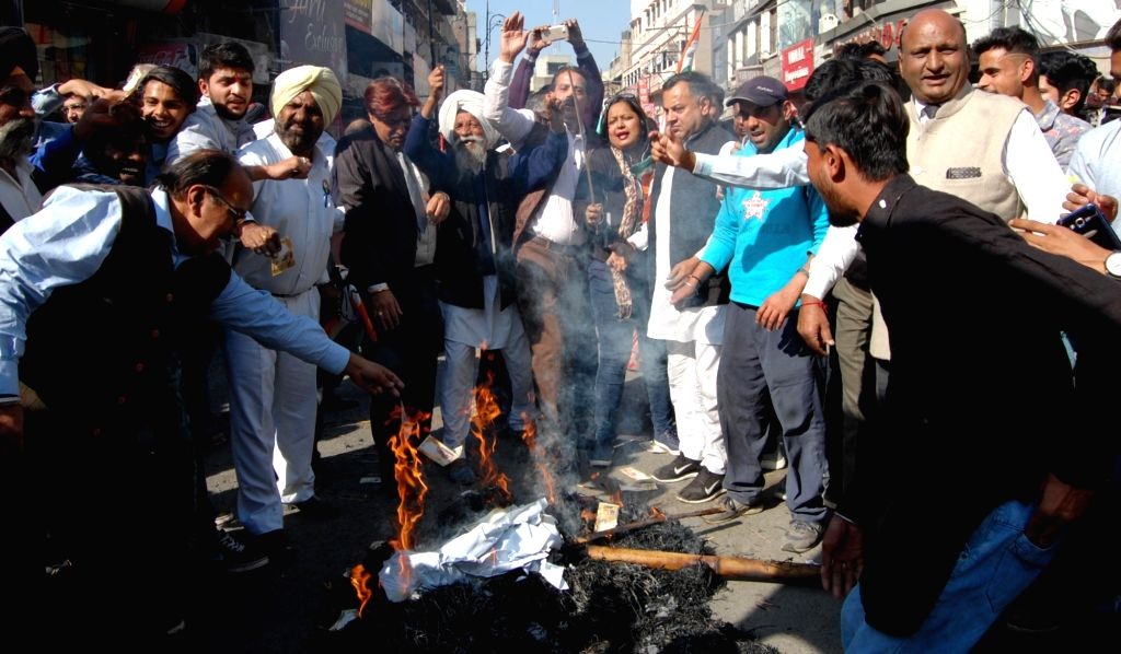 Congress workers participate in a march against demonetisation in Amritsar on Nov 28, 2016.
