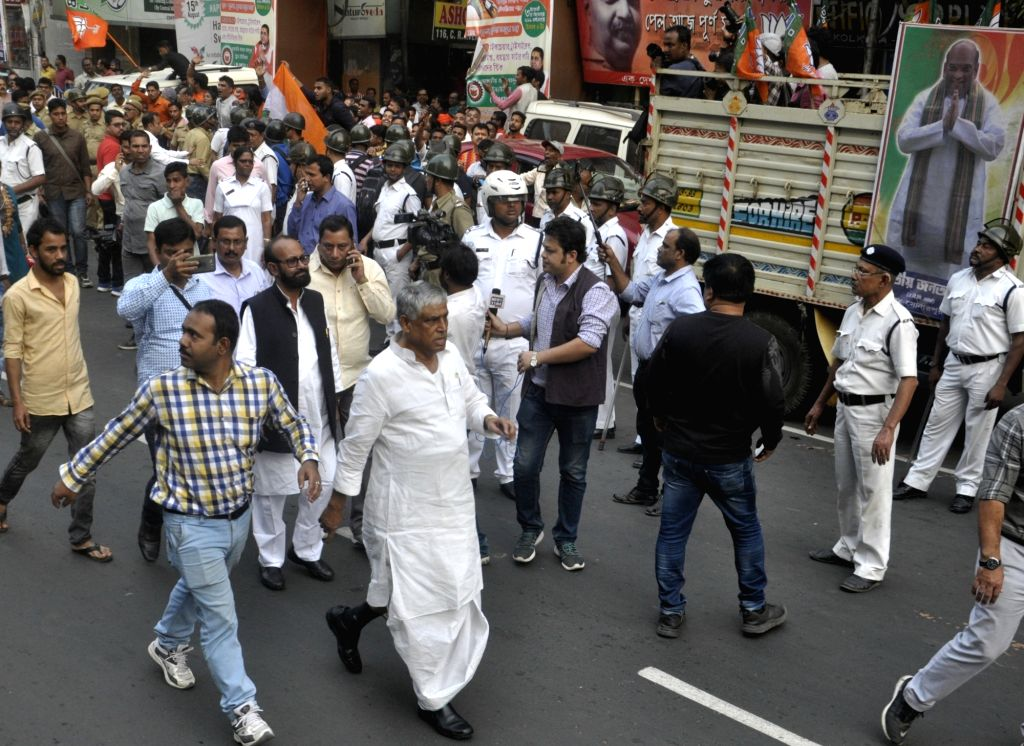 Congress workers participate in a protest rally against Kolkata Municipal Corporation (KMC) over their various demands, on Dec 19, 2019.