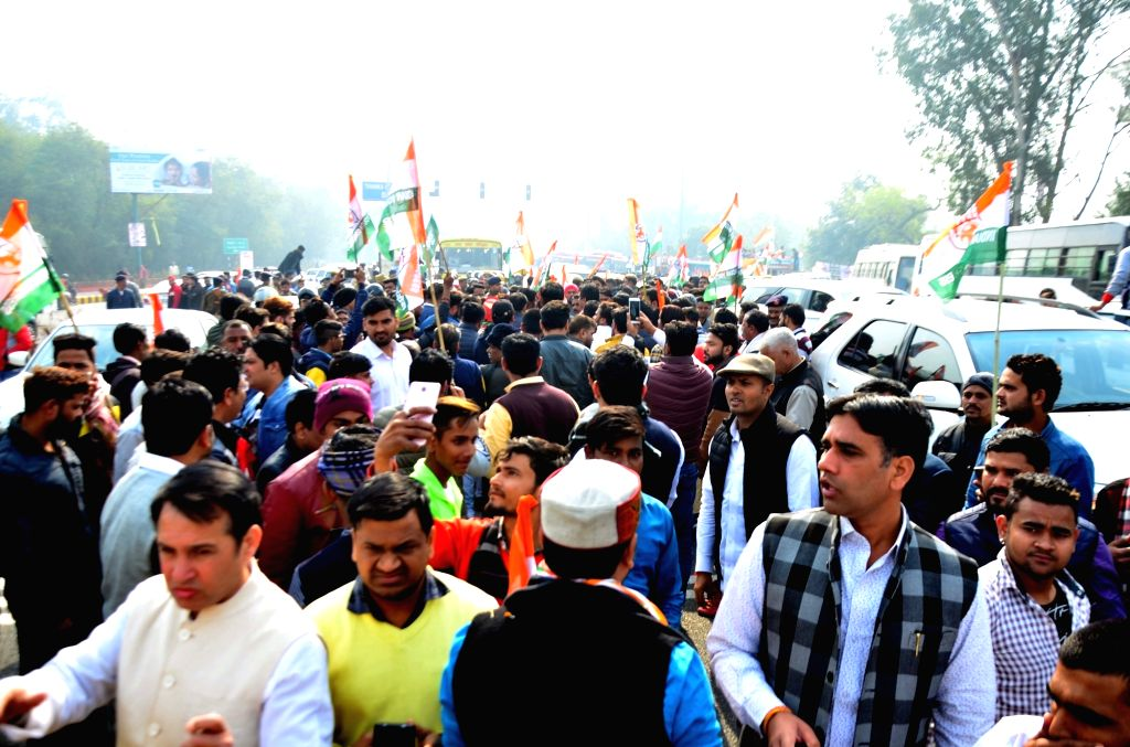 Congress workers participate in a rally against alleged scam in Rafale deal in Sector 14, Noida on Jan 30, 2019.