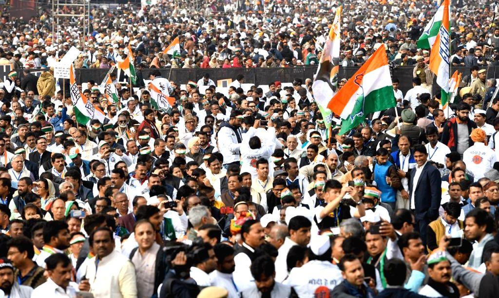 Congress workers participate in 'Bharat Bachao' Rally organised by the party against BJP's governance at Ramlila Maidan in New Delhi on Dec 14, 2019.