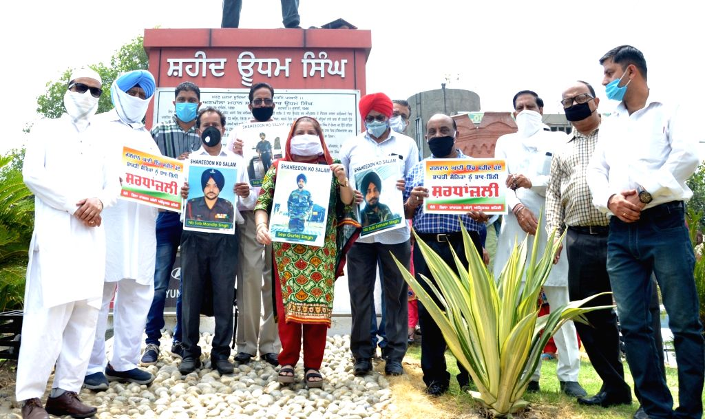 Congress workers paying their tributes to the 20 Indian Army bravehearts who were martyred in a violent clash with the Chinese troops in the Galwan Valley in Eastern Ladakh; in Amritsar on ...