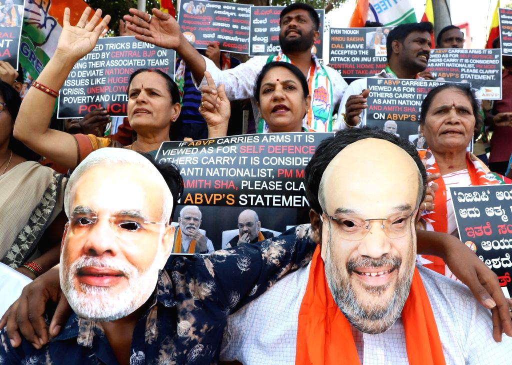 Congress workers protest against the BJP-led Central Government over JNU violence, demanding strict action against the culprits, in Bengaluru on Jan 9, 2020.
