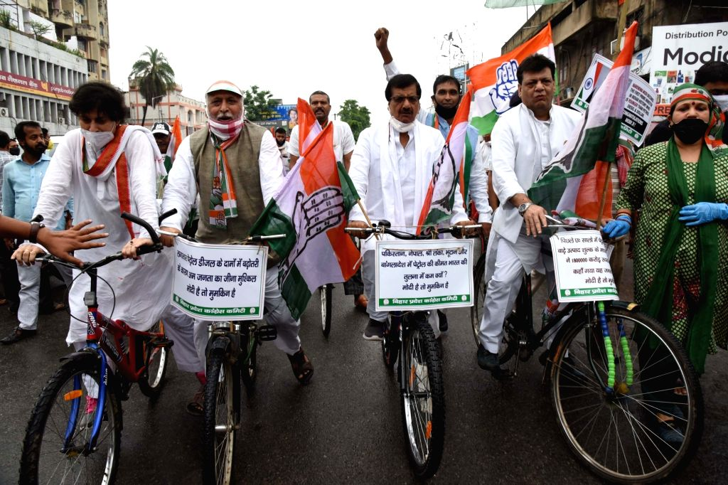 Congress workers protest against the incessant and unregulated hike in the prices of petrol and diesel, in Patna on June 29, 2020.