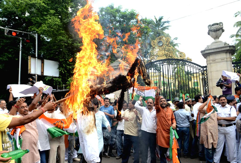 Congress workers stage a demonstration against the suspension of Congress MPs in Kolkata, on Aug 4, 2015.