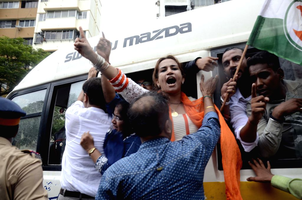 Congress workers stage a demonstration against suspension of party MPs, in Mumbai, on Aug 5, 2015.