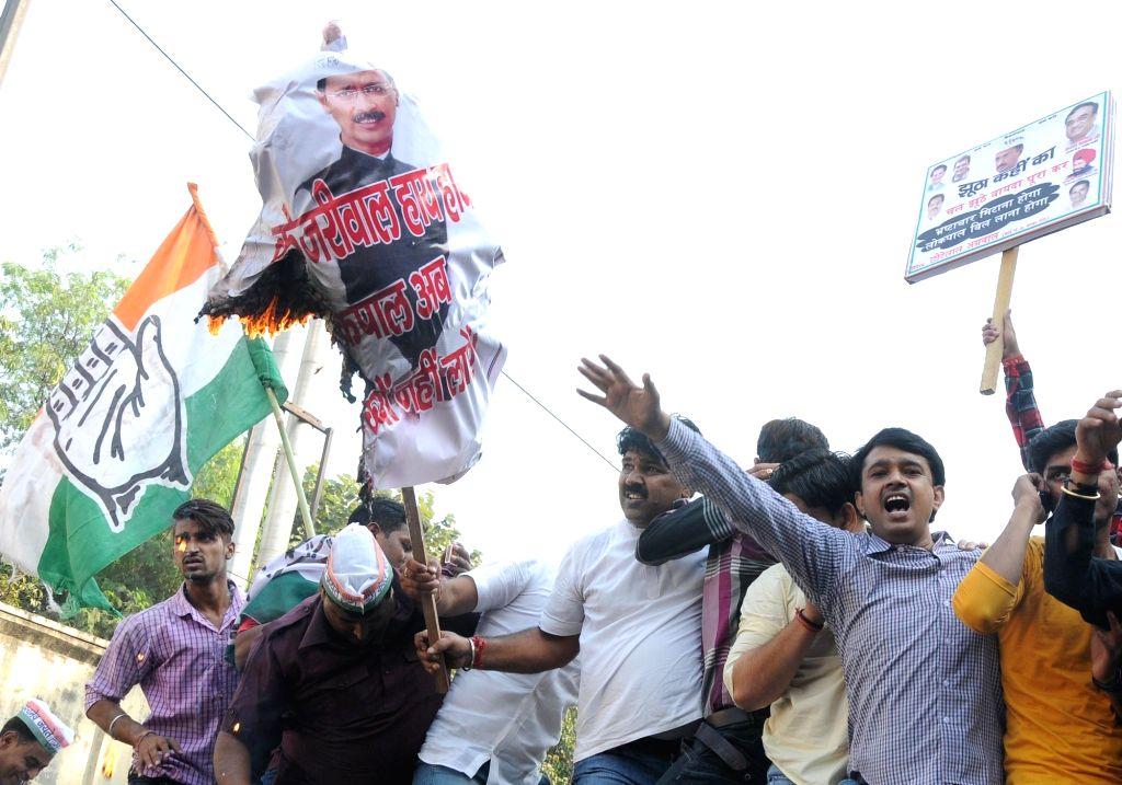 Congress workers stage a demonstration against Delhi Chief Minister Arvind Kejriwal  in New Delhi, on Nov 18, 2015. - Arvind Kejriwal
