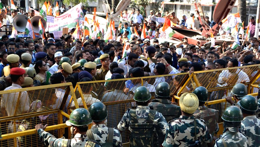 Congress workers stage a demonstration against Assam Governor P B Acharya in Guwahati on Nov 27, 2015.