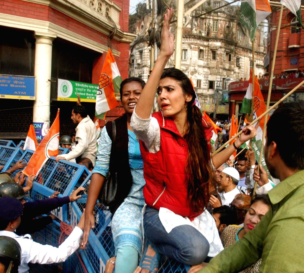 Congress workers stage a demonstration against West Bengal government in front of Kolkata Municipal Corporation in Kolkata, on Jan 18, 2016.