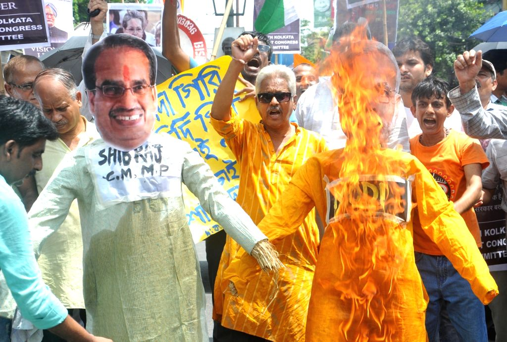 Congress workers stage a demonstration against killing of five farmers in Madhya Pradesh's Mandsaur district, in Kolkata on June 10, 2017.