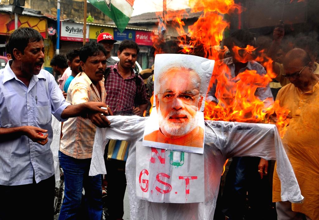 Congress workers stage a demonstration against GST in Kolkata, on July 2, 2017.