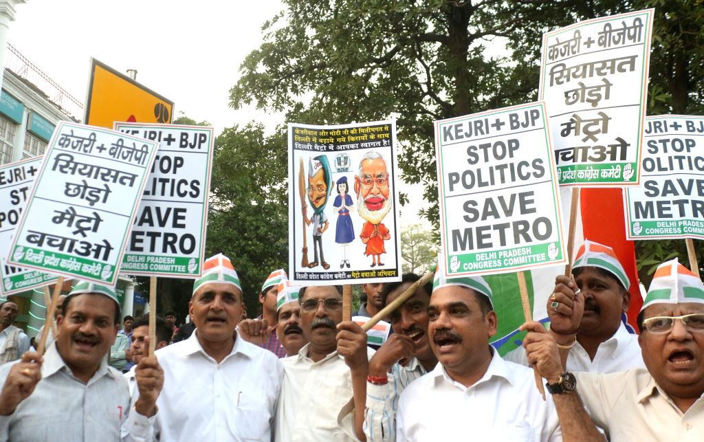 Congress workers stage a demonstration against hike in metro fares at Rajiv Chowk metro station in New Delhi on Oct 11, 2017.