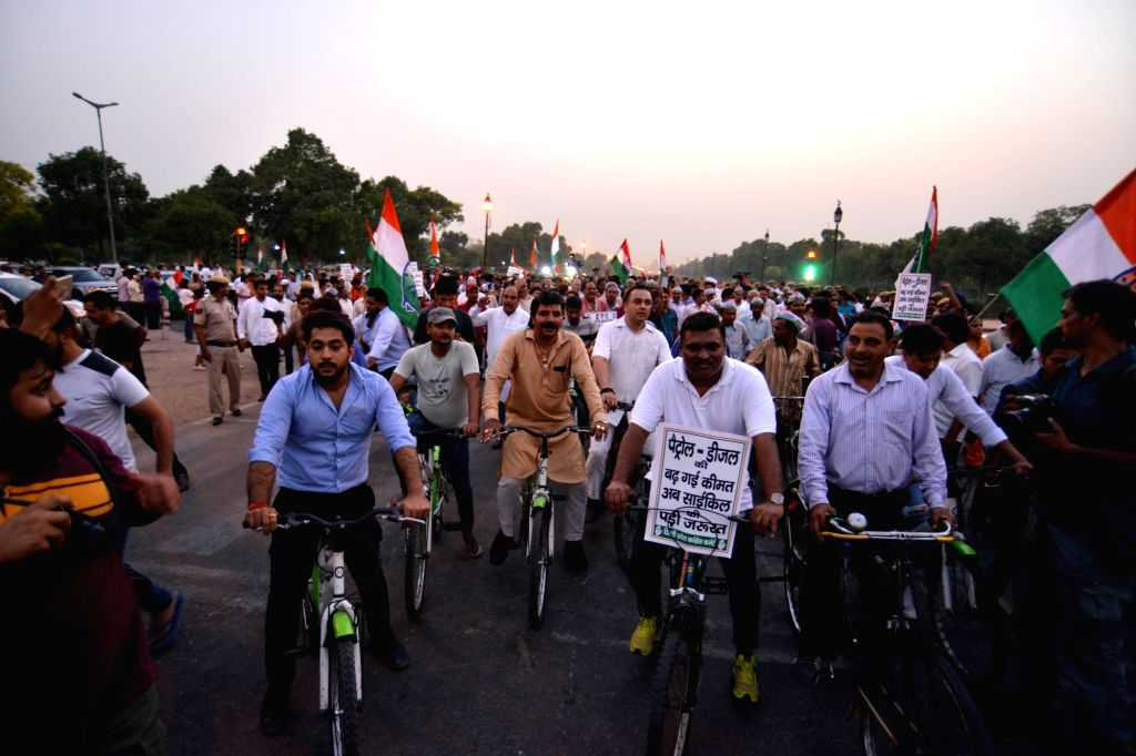 Congress workers stage a demonstration against hike in fuel prices at Rajpath in New Delhi, on May 22, 2018.