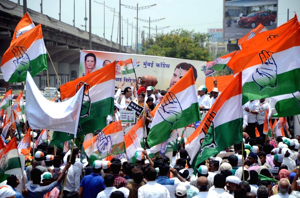 Congress workers stage a demonstration against the hike in petrol and diesel prices, in Mumbai on May 24, 2018.