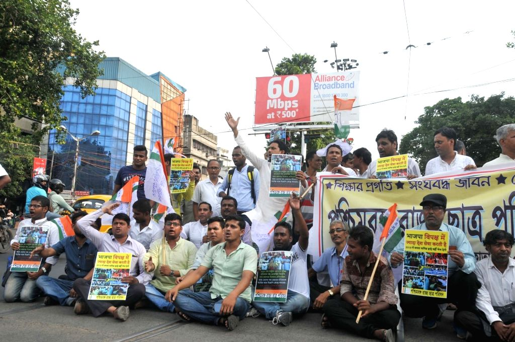 Congress workers stage a demonstration against hike in fuel prices in Kolkata on May 24, 2018.