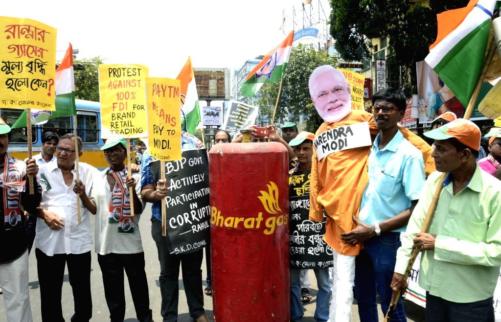 Congress workers stage a demonstration against Prime Minister Narendra Modi on the occasion of 4th anniversary of Narendra Modi-led BJP government, in Kolkata on May 26, 2018. - Narendra Modi