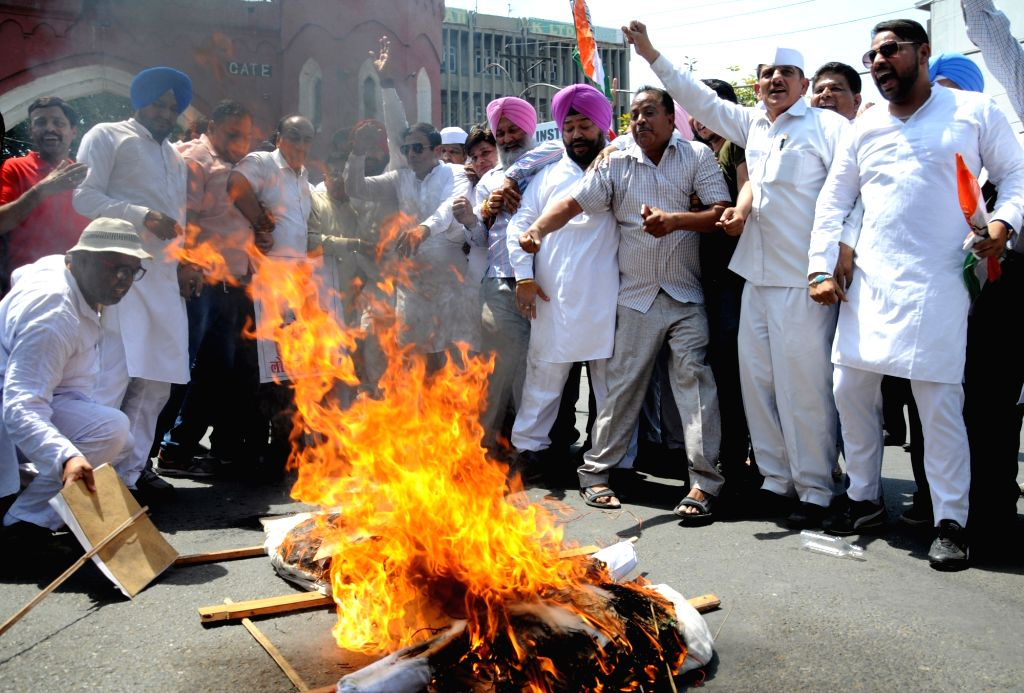 Congress workers stage a demonstration against the Central Government on the occasion of the 4th anniversary of Narendra Modi-led BJP government, in Amritsar on May 26, 2018. - Narendra Modi