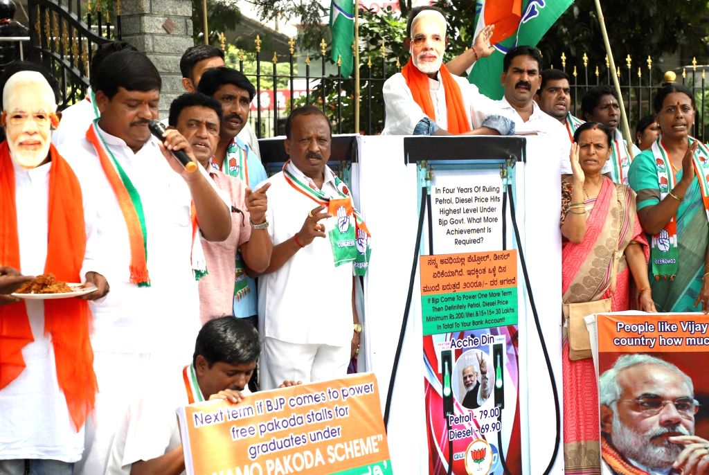 Congress workers stage a demonstration against the Central Government on the occasion of  the 4th anniversary of Narendra Modi-led BJP government, in Bengaluru on May 26, 2018. - Narendra Modi