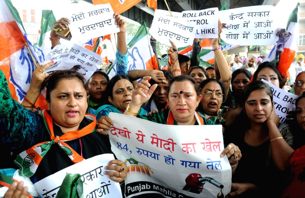 Congress workers stage a demonstration against hike in the prices of petrol and diesel, in Amritsar on May 31, 2018.