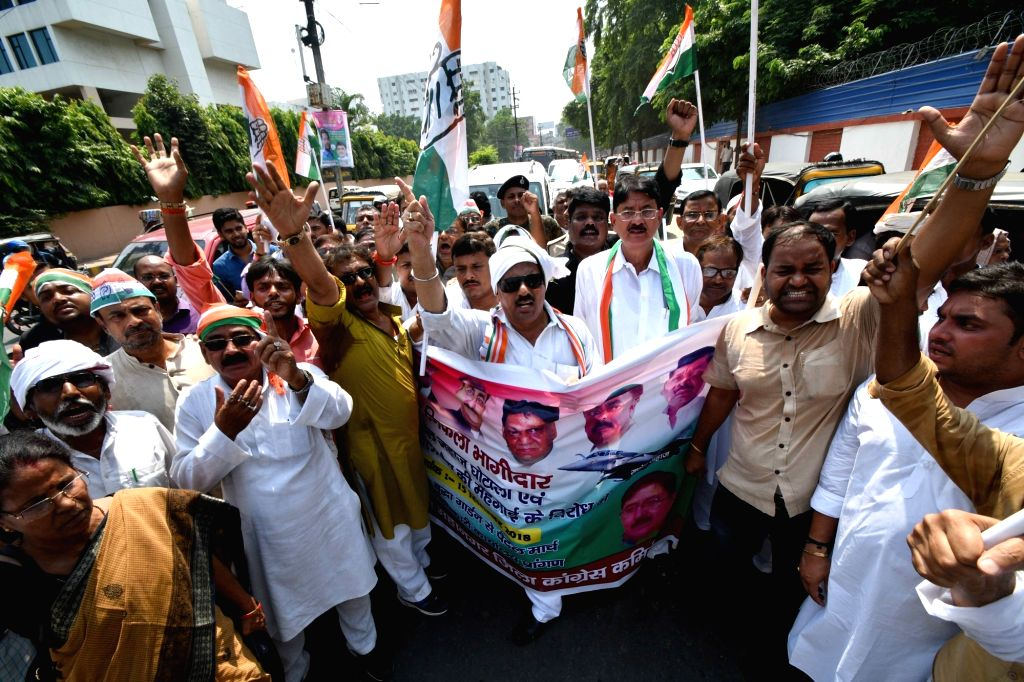Congress workers stage a demonstration against rising fuel prices and alleged corruption in the Rafael deal; in Patna on Sept 15, 2018.