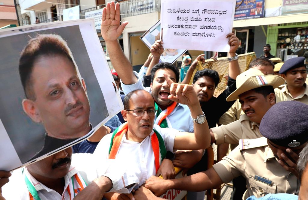"Congress workers stage a demonstration against Union Minister Ananth Kumar Hegde in Bengaluru, on Jan 29, 2019. Hegde during his speech on Sunday in Kodagu district remarked that ""any ... - Ananth Kumar Hegde"