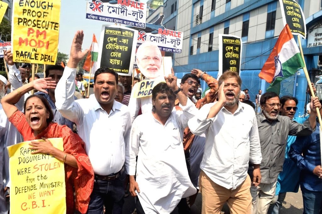 Congress workers stage a demonstration against the Central Government over Rafale deal, in Kolkata, on March 7, 2019.