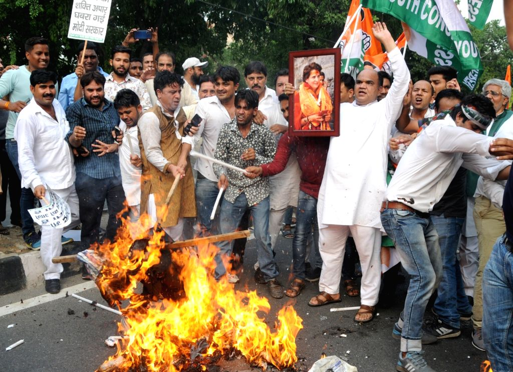 Congress workers stage a demonstration against the detention of Congress leader Priyanka Gandhi by the Uttar Pradesh police when she was proceeding to meet the victims of the Sonebhadra ... - Priyanka Gandhi