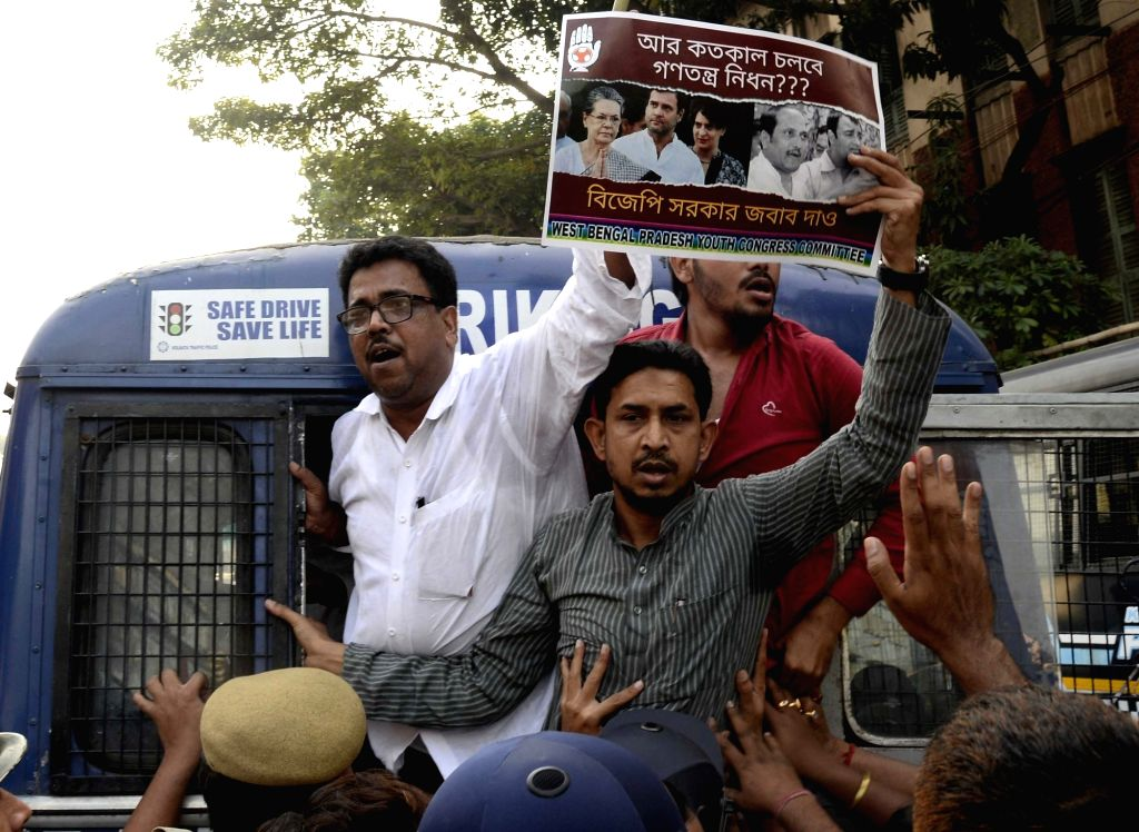 Congress workers stage a demonstration against the BJP in Kolkata on Nov 16, 2019.