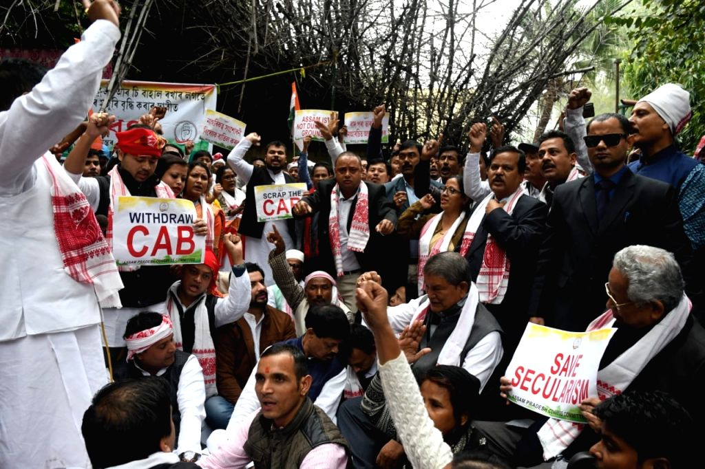 Congress workers stage a demonstration against the Citizenship Amendment Bill (CAB) 2019 and NRC, in New Delhi on Dec 13, 2019.