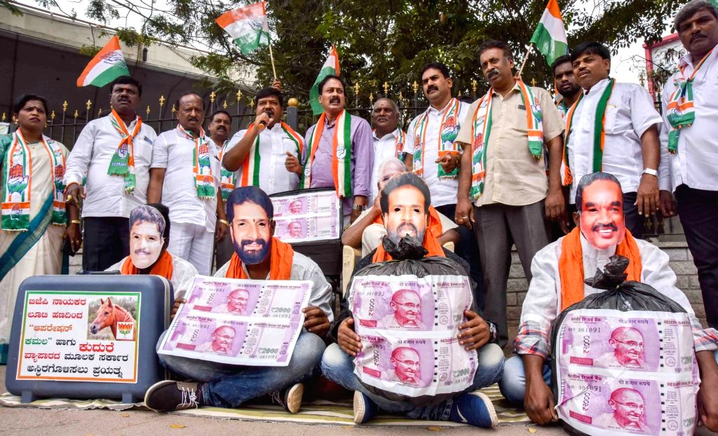 Congress workers stage a demonstration to protest against BJP for alleged horse trading in Bengaluru, on  Feb 9, 2019.