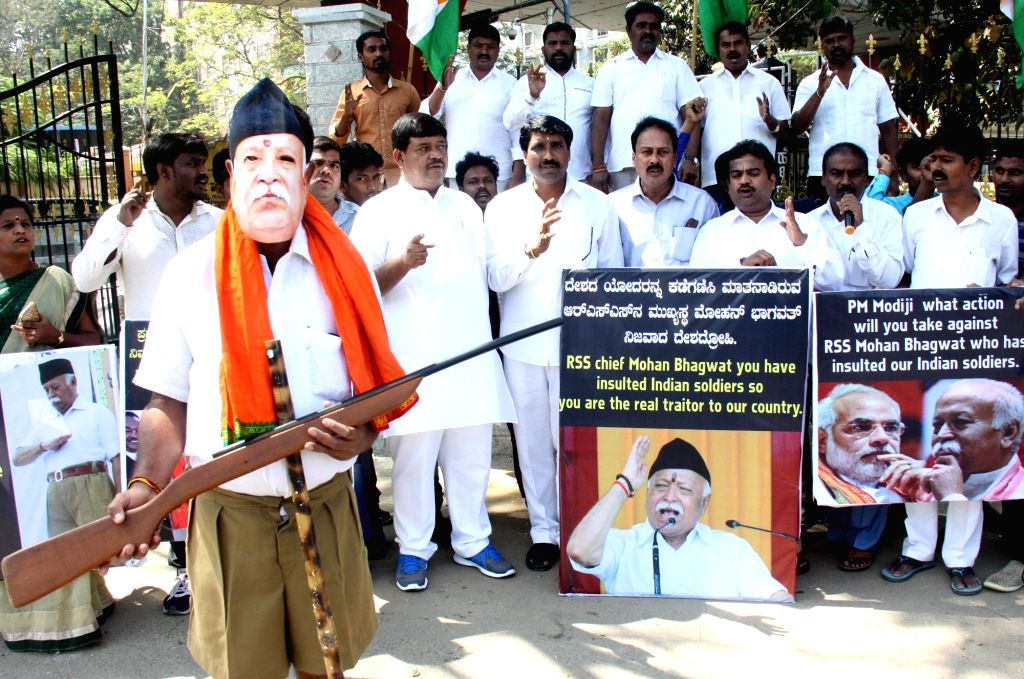 Congress workers stage silent demonstration against RSS chief Mohan Bhagwat over his statement that RSS could raise an army in three days; in Bengaluru on Feb 14, 2018.