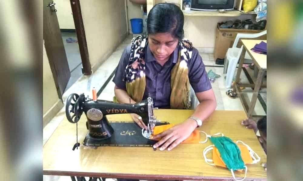 Constable Amareswari stitching masks.
