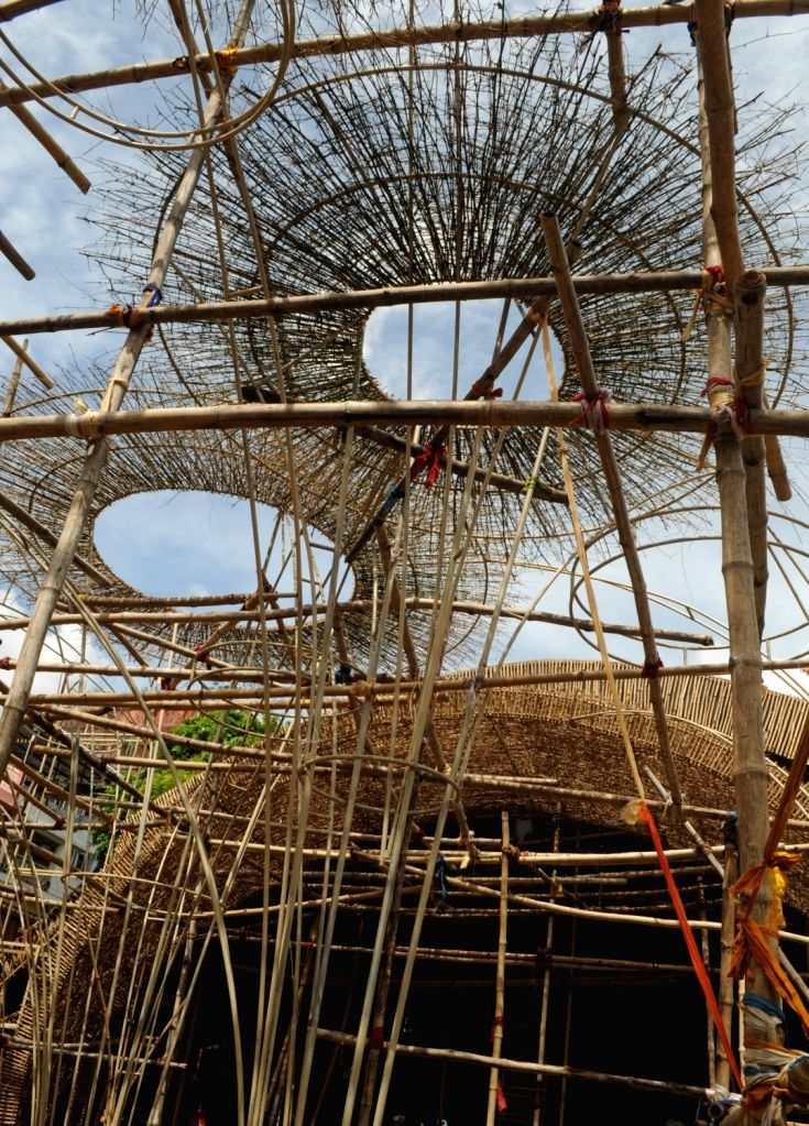 Construction of a community puja pandal underway ahead of Durga Puja celebrations, in Kolkata on Oct 1, 2020.