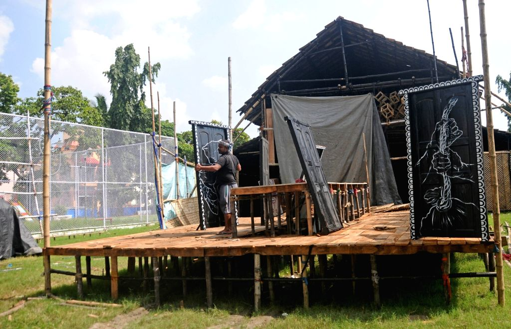 Construction of a Durga Puja pandal underway ahead of Durga Puja celebrations in Kolkata on Oct 12, 2020.