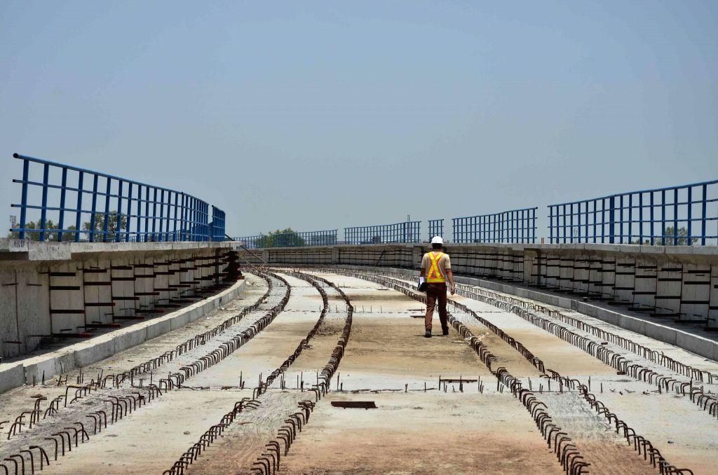 Construction work underway on the under Jahangirpuri - Badli section of Delhi Metro in New Delhi on July 11, 2014.
