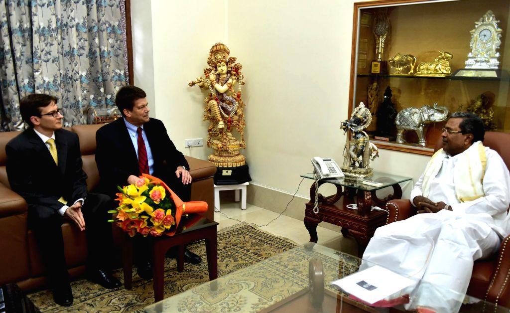 Consulate General of the United States of America (USA) Robert Burgess calls on Karnataka Chief Minister Siddaramaiah at his residence in Bengaluru on Sept 18, 2017. - Siddaramaiah