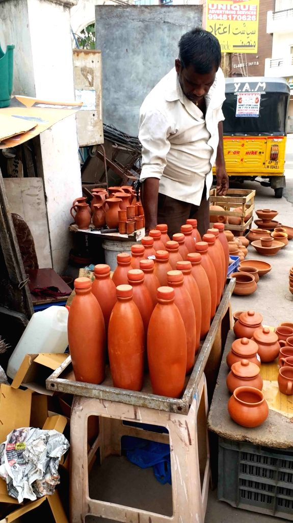 Containers and other articles made up of clay being sold at a streetside stall in Hyderabad during the extended nationwide lockdown imposed to mitigate the spread of coronavirus; on Apr ...