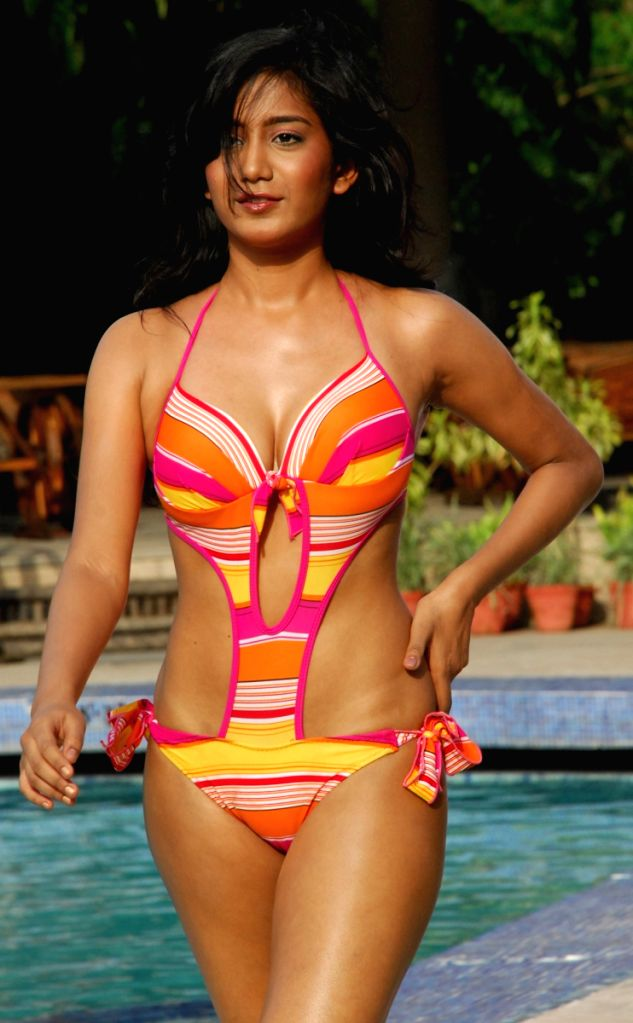 "Contestant pose for photographers during the swimwear round of ""Dabur Gulabari Sananda Tilottama"" on Wednesday in Vedic Village of Kolkata on 10 Jun 09. Ten finalists were present for the sw"