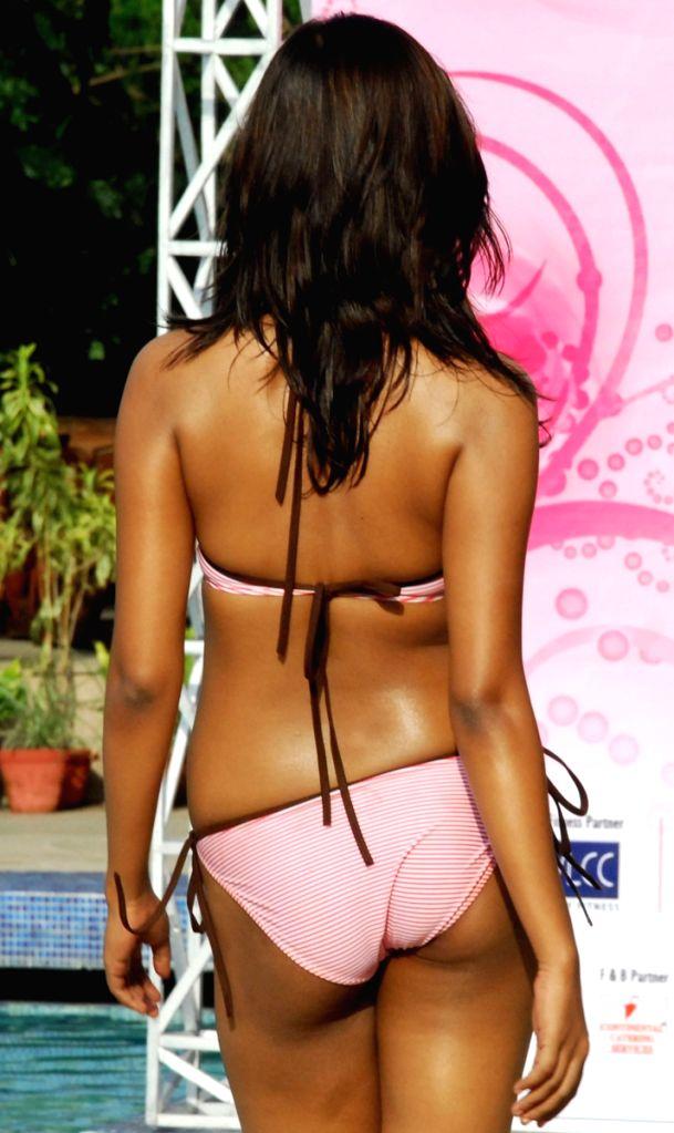 "Contestant pose for photographers during the swimwear round of ""Dabur Gulabari Sananda Tilottama"" on Wednesday in Vedic Village of Kolkata on 10 Jun 2009. Ten finalists were present for the"