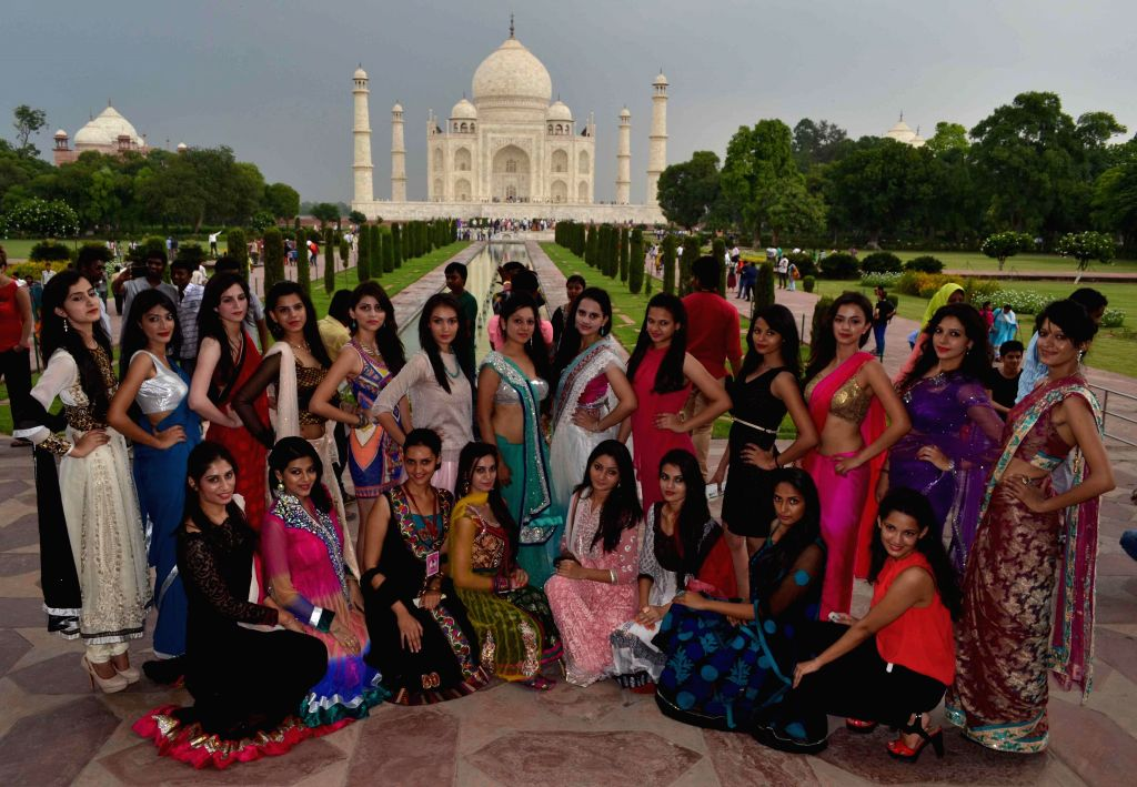 Contestants of Dabur Miss North India poses for a photograph at Taj Mahal in Agra on Aug 28, 2014.