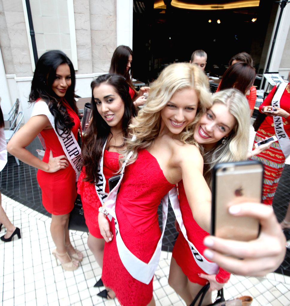 Contestants of the Miss Global International 2015 take a selfie during a press presentation in Pasay City, the Philippines, Oct. 14, 2015. Contestants from ...
