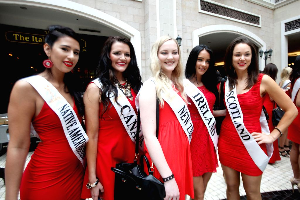 Contestants of the Miss Global International 2015 attend a press presentation in Pasay City, the Philippines, Oct. 14, 2015. Contestants from around the world ...