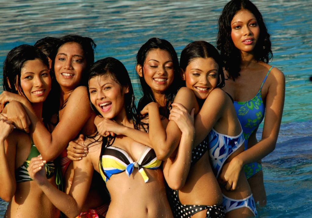 "Contestants pose for photographers during the swimwear round of ""Dabur Gulabari Sananda Tilottama"" on Wednesday in Vedic Village of Kolkata on 10 Jun 09. Ten finalists were present for the s"