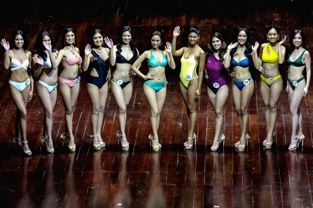 Contestants pose onstage during the final screening of candidates for the Binibining PIlipinas (Miss Philippines) 2020 beauty pageant in Quezon City, the ...