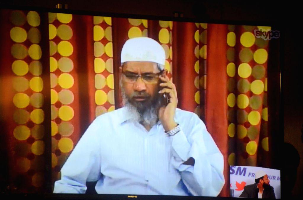 Controversial Islamic preacher Zakir Naik addresses a press conference through Skype in Mumbai, on July 15, 2016.